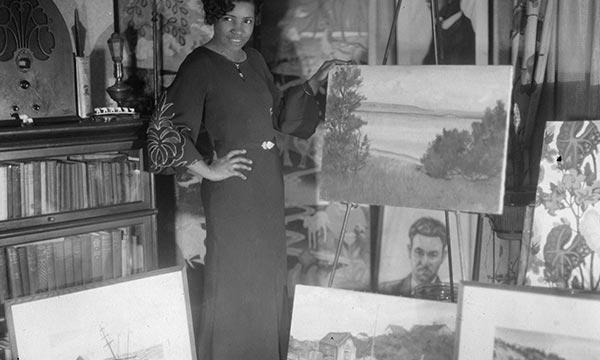 Jones and her paintings in Washington, DC, circa 1931