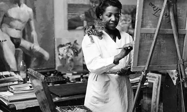 Jones in her Paris studio with kitten, circa 1938